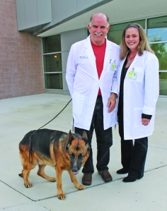 Richard Gonzmart with his wife Melanie and Rusty in front of the University of Florida Veterinary School of Medicine in Gainesville, Florida.