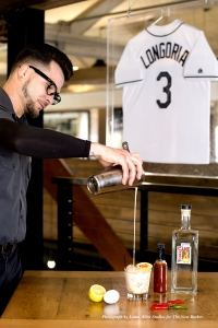 """Learning about spirits enhances my need to know. It Intrigues me and made me realize I'm a history buff. After work, I go home and read books about booze, then create new drinks."" Mixologist, Chuck Cooper, pouring a Hair Of The Dog."