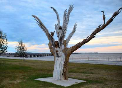 The Angel Tree. Nikki and her friends commissioned an artist to carve an angel into the tree that saved their lives.